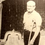 Fred Calloway Standing by Church Bell